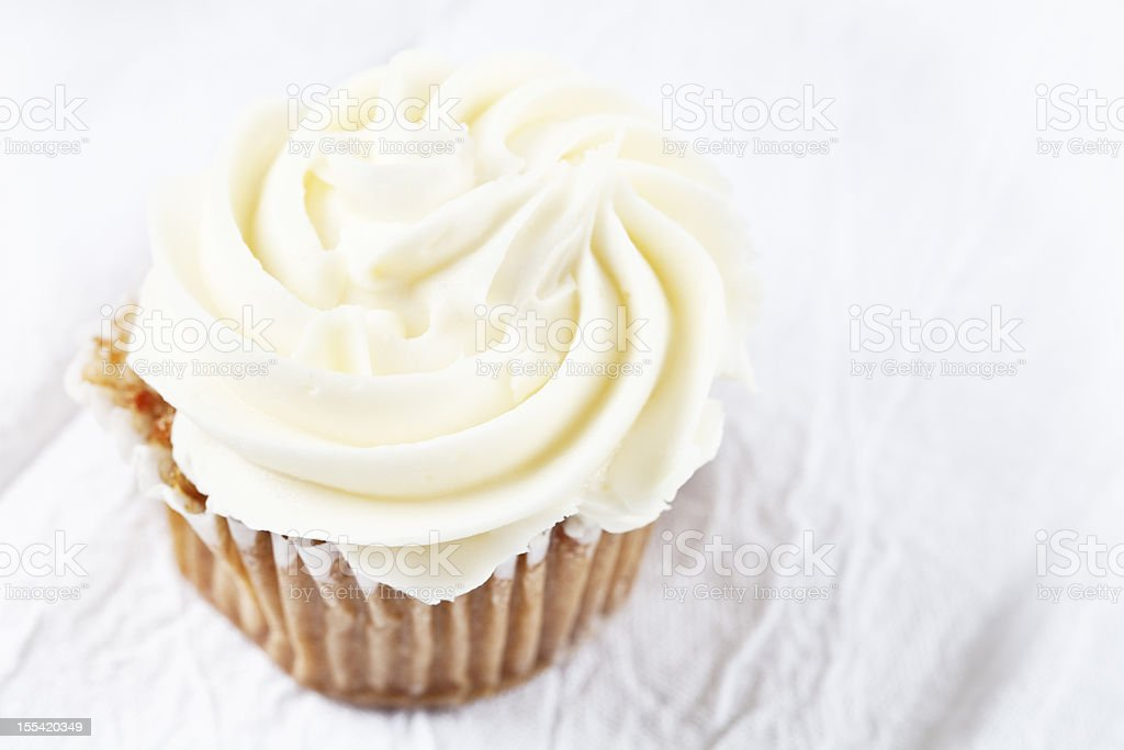 carrot cupecake with vanilla icing stock photo