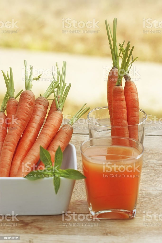 Carrot juice and carrots royalty-free stock photo