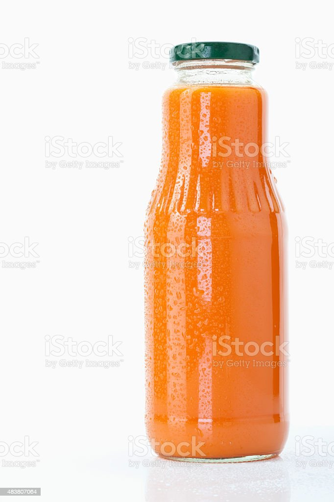 Carrot juice bottle on white background,close up stock photo