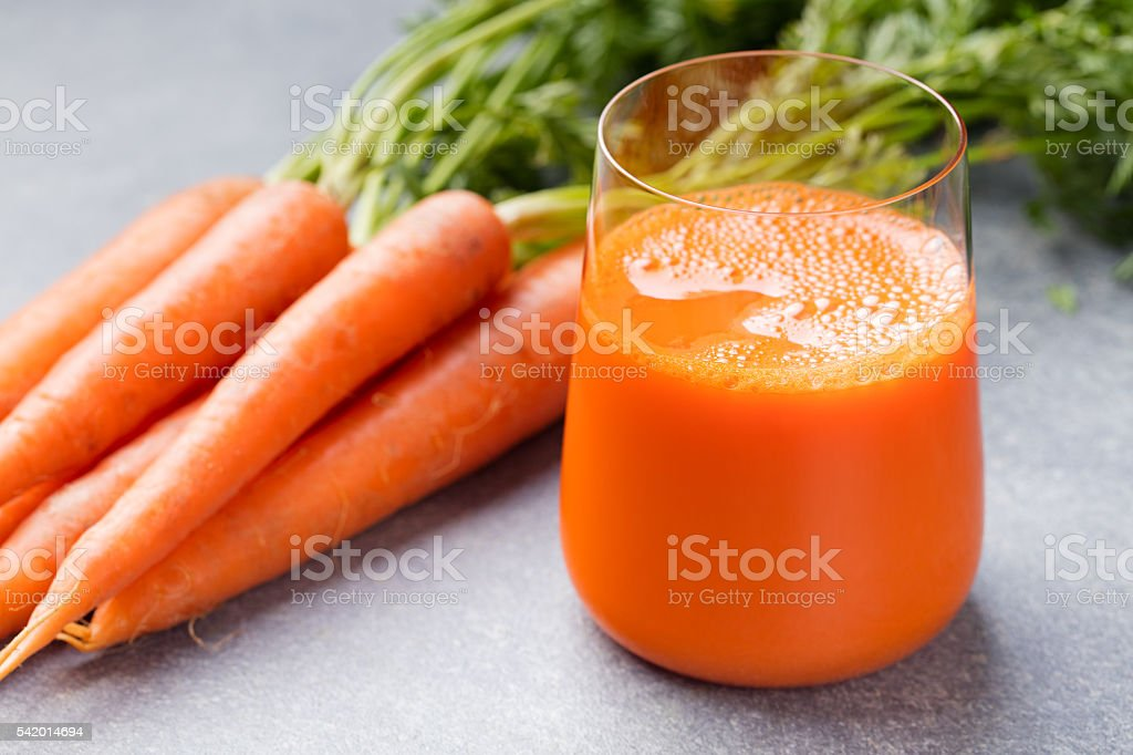 Carrot juice in glass and fresh carrots Healthy food stock photo