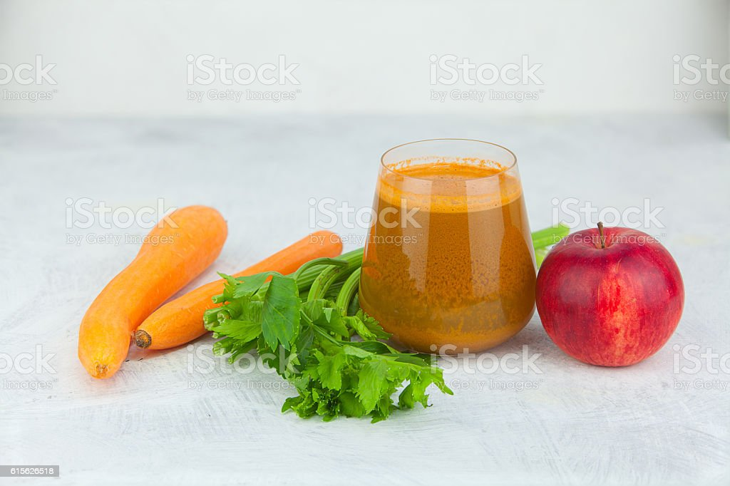 carrot juice in glass on  table stock photo