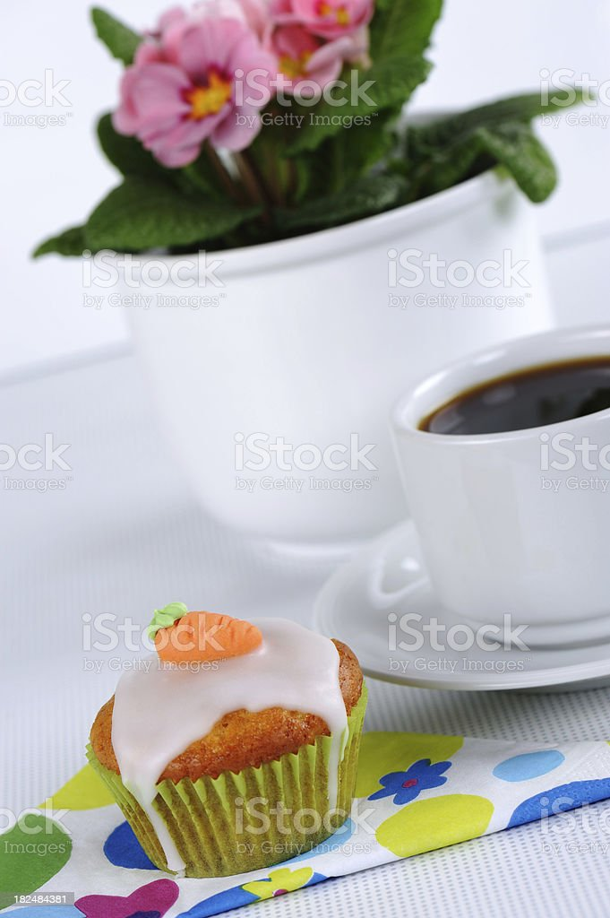 Carrot Muffin on colored Napkin with Coffee and Flower stock photo