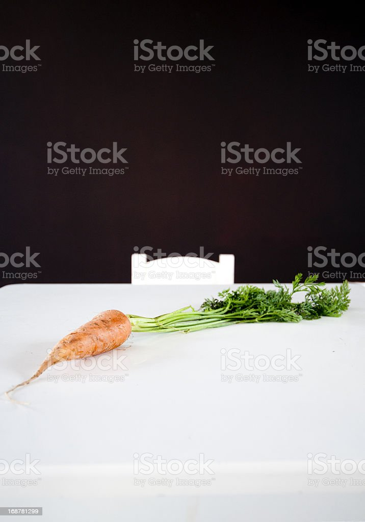 Carrot on white table royalty-free stock photo
