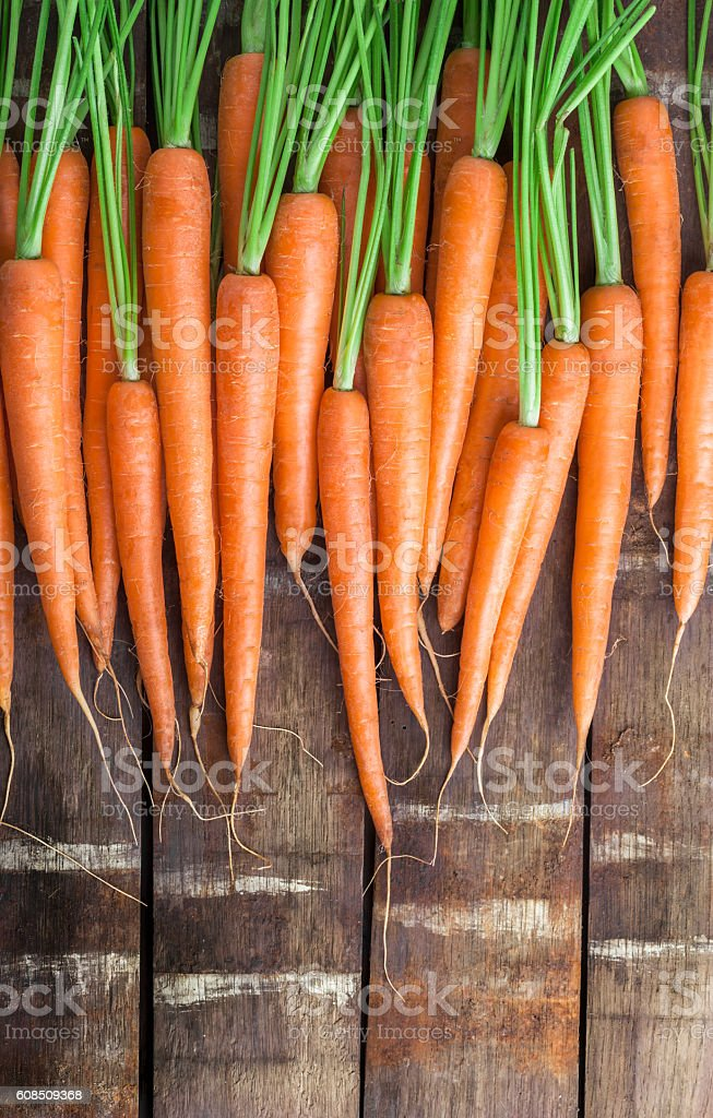 Carrot overhead group lined up on old rustic wooden table stock photo