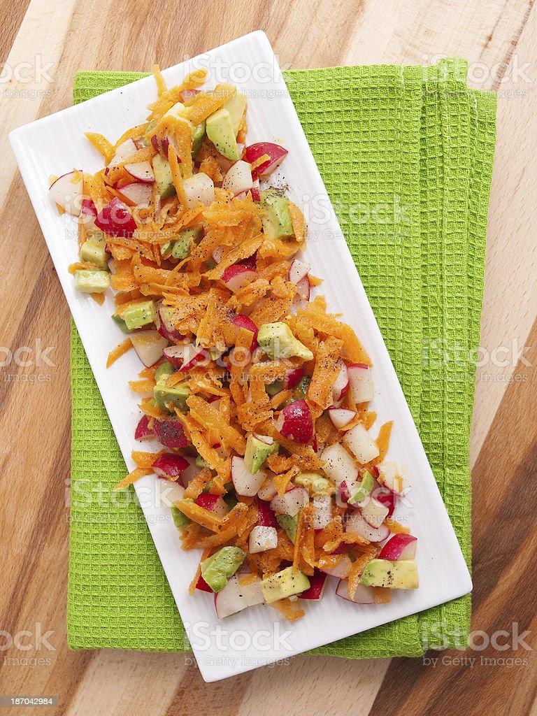 Carrot salad with radish and avocado royalty-free stock photo