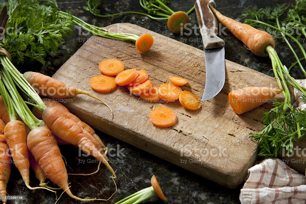 Carrot slices on cutting board royalty-free stock photo