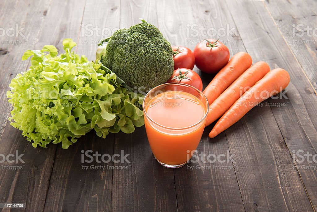 Carrot smoothie with fresh ingredients and vegetable. stock photo