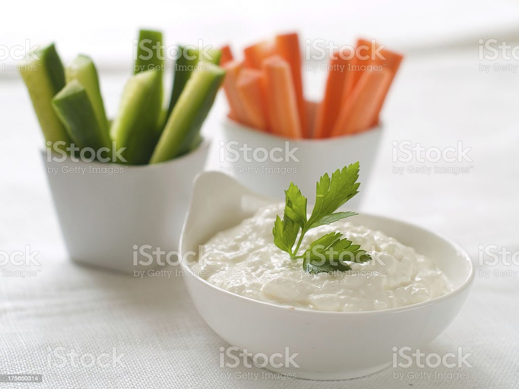Carrots and cucumber with garlic yogurt dip stock photo