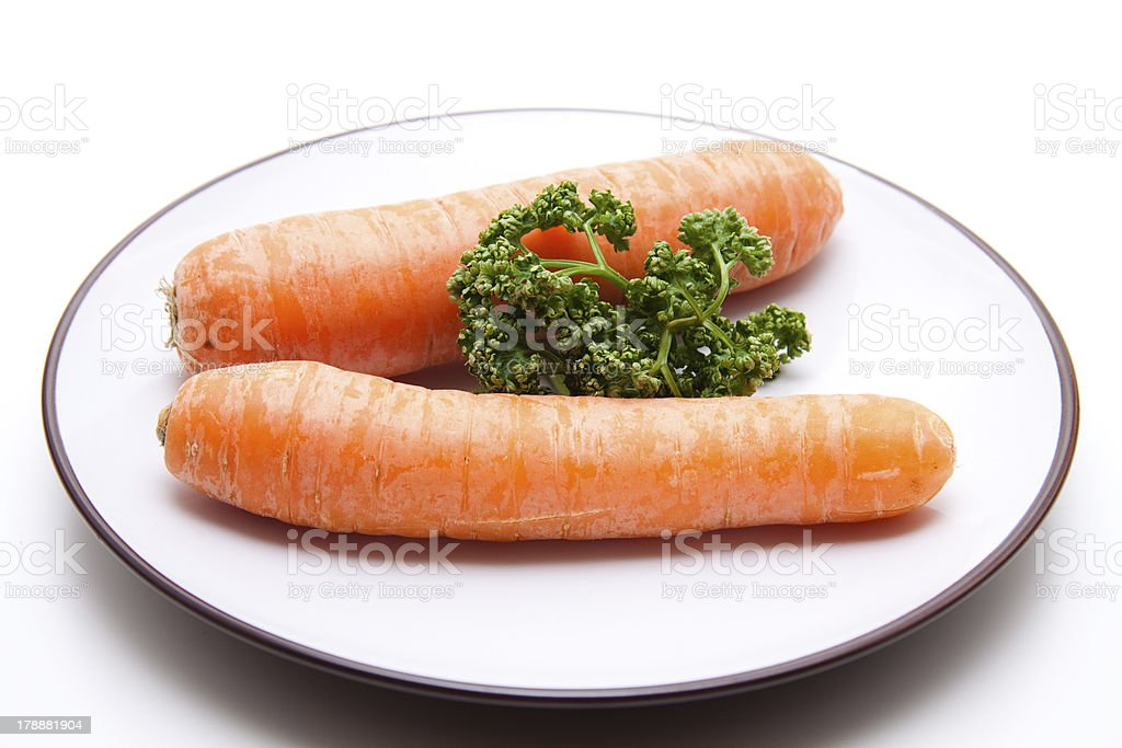 Carrots and parsley on plate stock photo