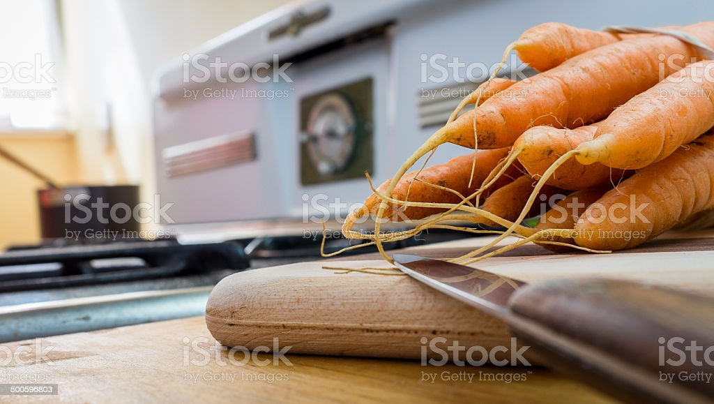 Carrots and stove royalty-free stock photo