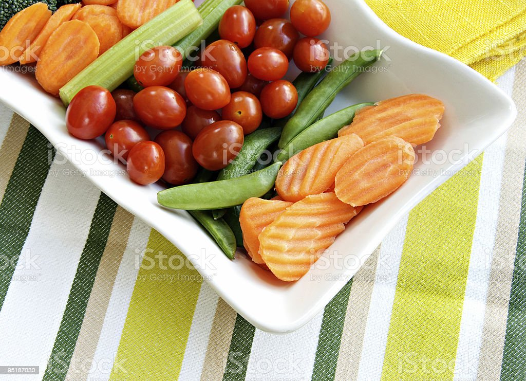 Carrots, Celery, Tomatoes, Broccoli, and Sugar Snap Peas royalty-free stock photo