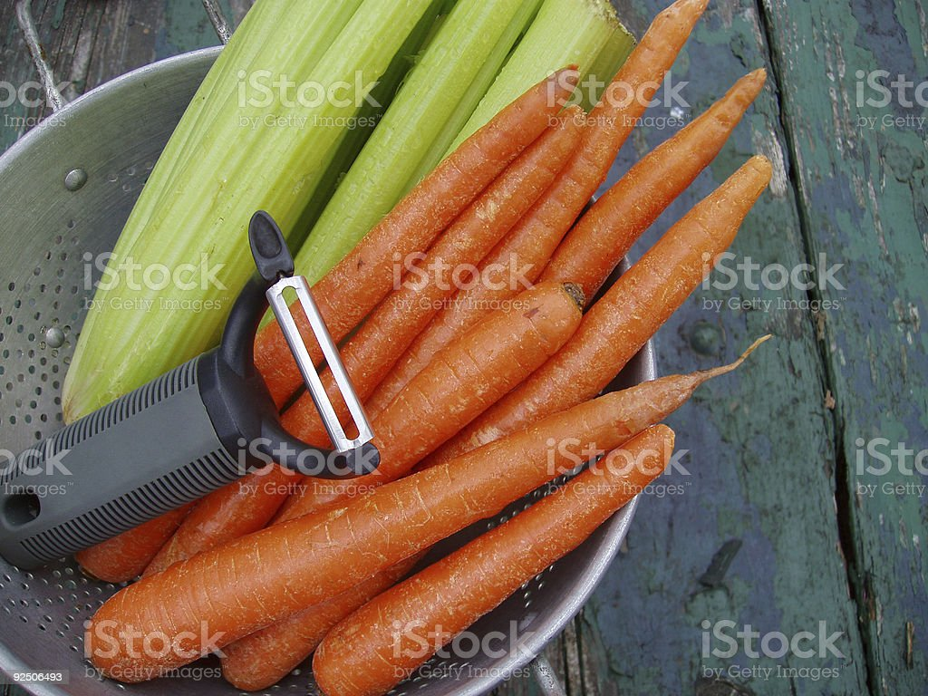 Carrots & Celery with Peeler - Fresh Vegetables stock photo