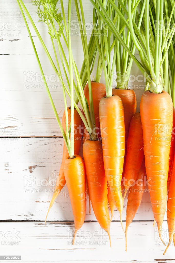 Carrots close up on white table stock photo