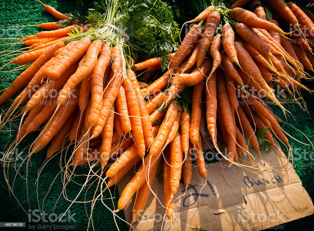 Carrots for sale, one pound a bunch stock photo