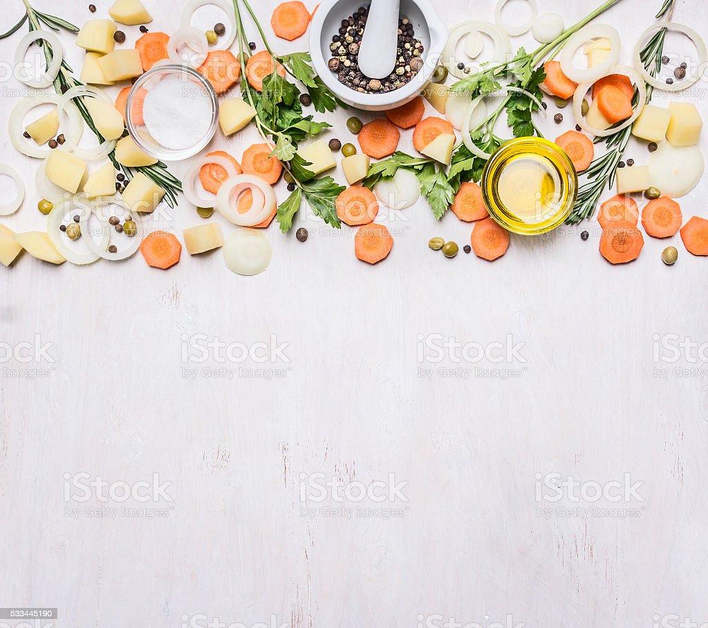 carrots, herbs, onions, butter, seasoning, sliced potatoes,  top view vegetarian stock photo