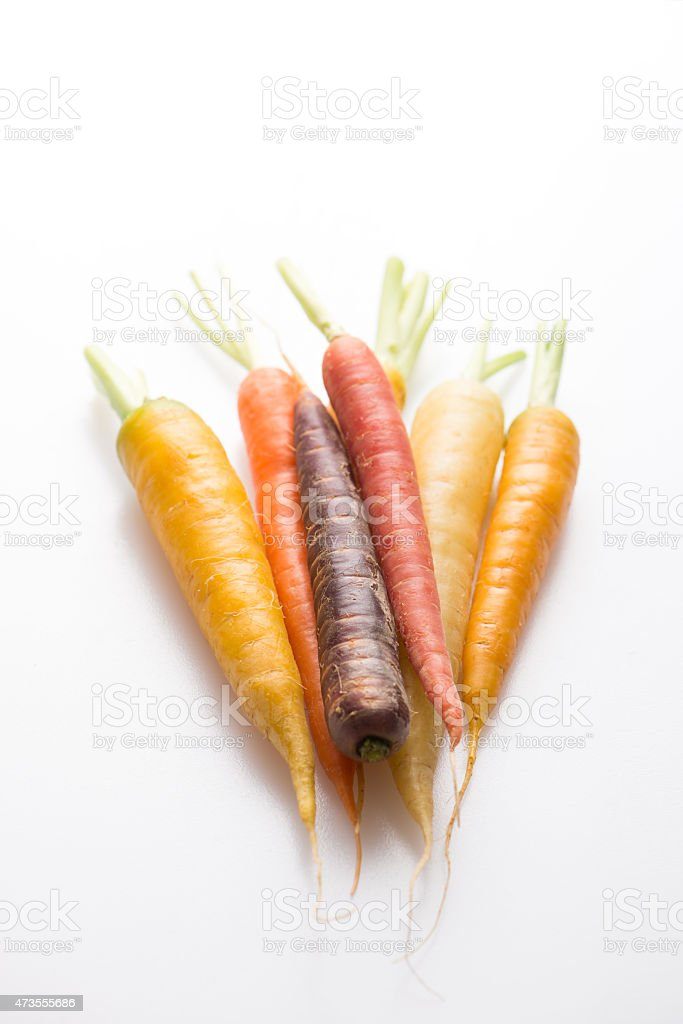 carrots in variety over white background stock photo