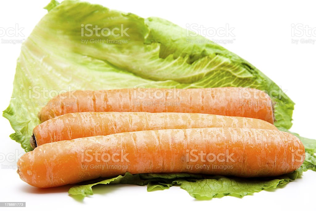 Carrots on salad leaf stock photo
