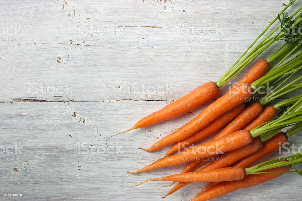 Carrots on the white background stock photo