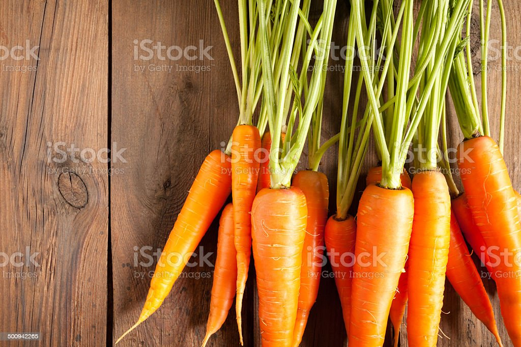 Carrots on wood stock photo