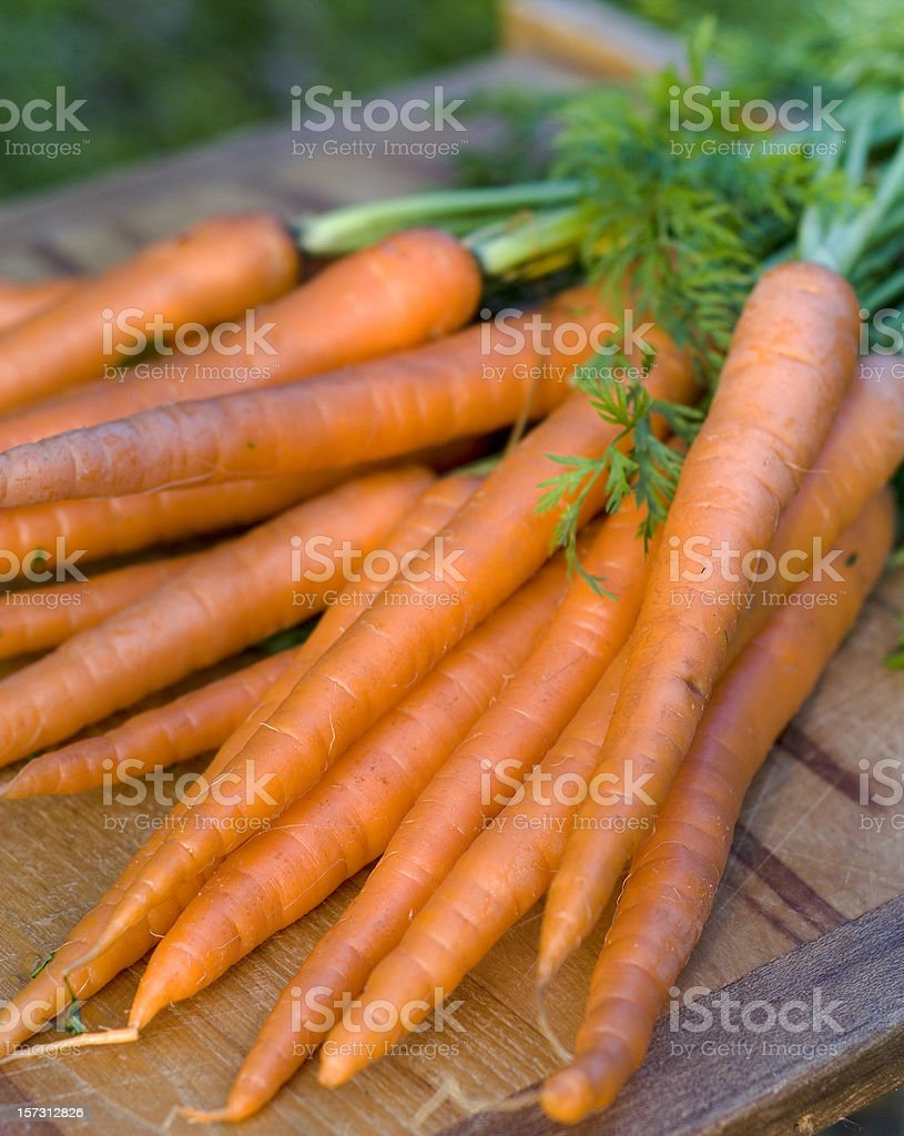 Carrots Root Vegetable, Fresh Organic Homegrown Produce on Cutting Board royalty-free stock photo
