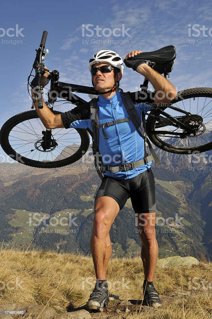 carry the bike royalty-free stock photo