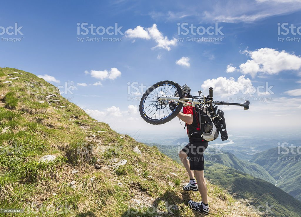 Carry the bike to the summit, Italy stock photo