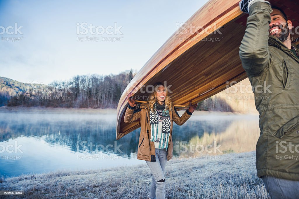 Carrying a canoe stock photo