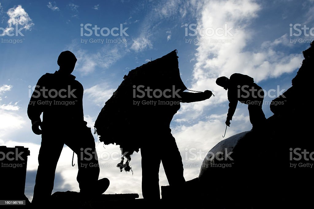 carrying a heavy sack royalty-free stock photo