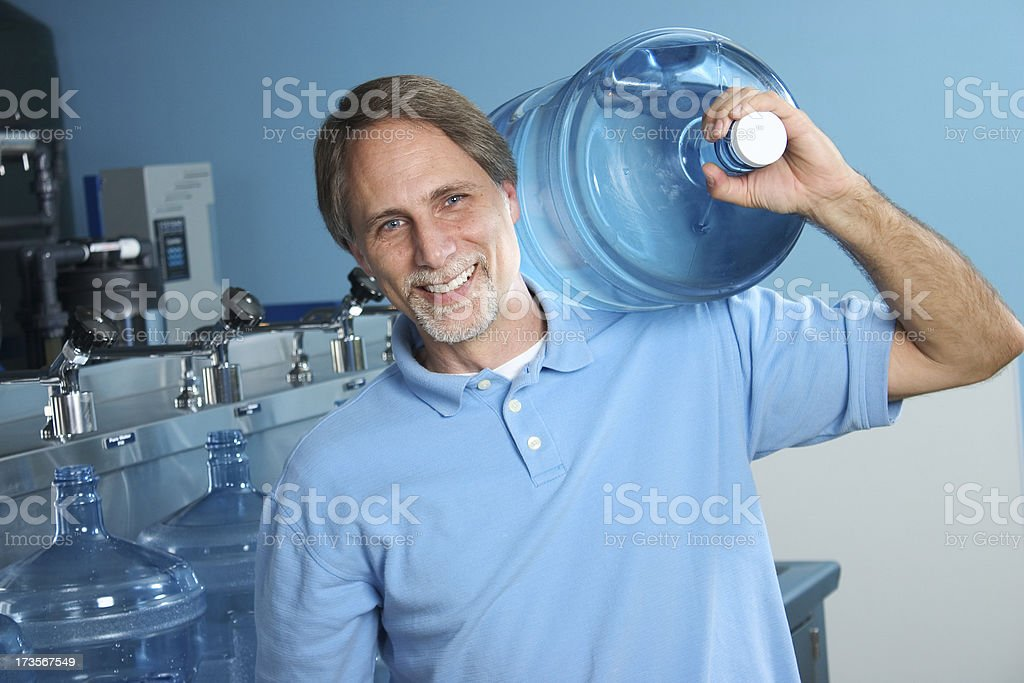 Carrying a Water Bottle royalty-free stock photo
