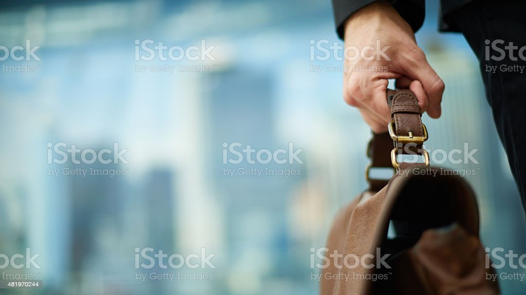Carrying briefcase stock photo
