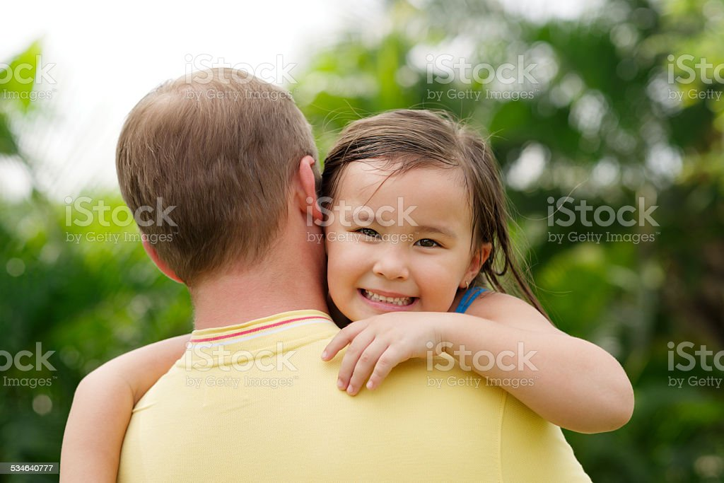 Carrying daughter stock photo