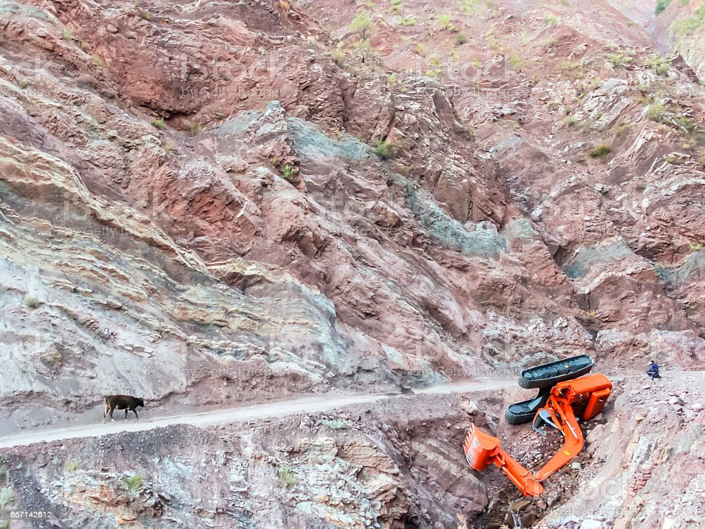 Carrying Excavator at the mountain road - Accident stock photo