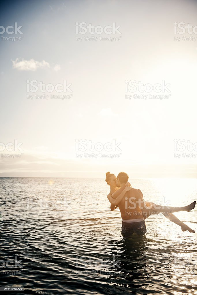 Carrying her off into the sunset stock photo