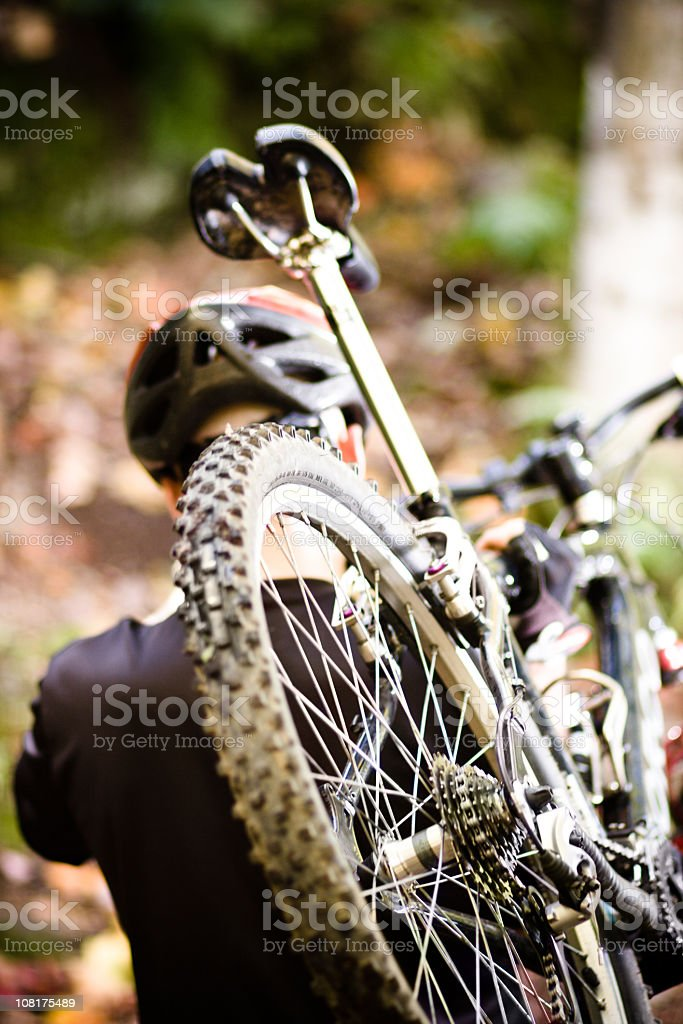 Carrying moutain bike uphill royalty-free stock photo