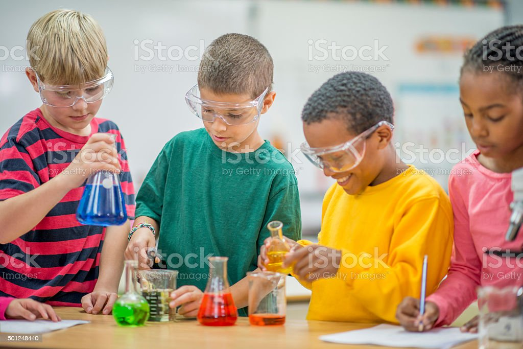Carrying out a Science Experiment in Class stock photo