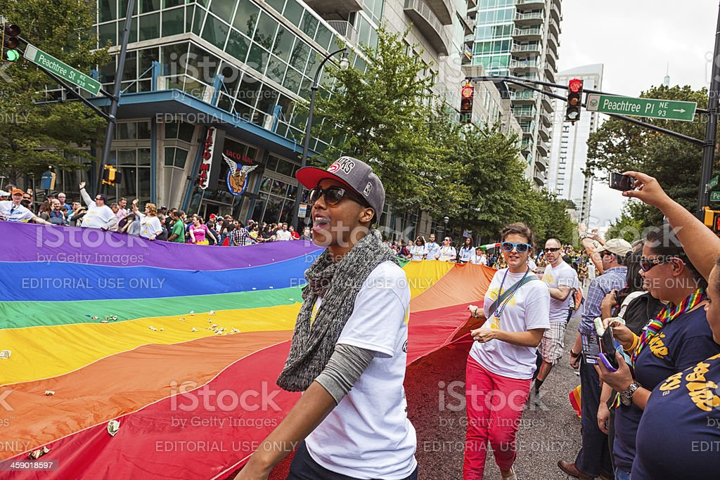 Carrying the giant Rainbow Flag stock photo