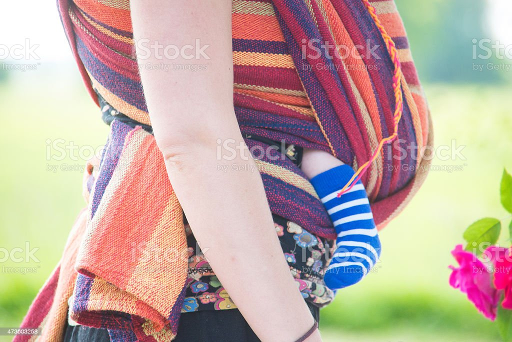 carrying young baby stock photo