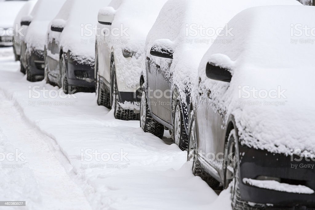 Cars after winter snowfall stock photo