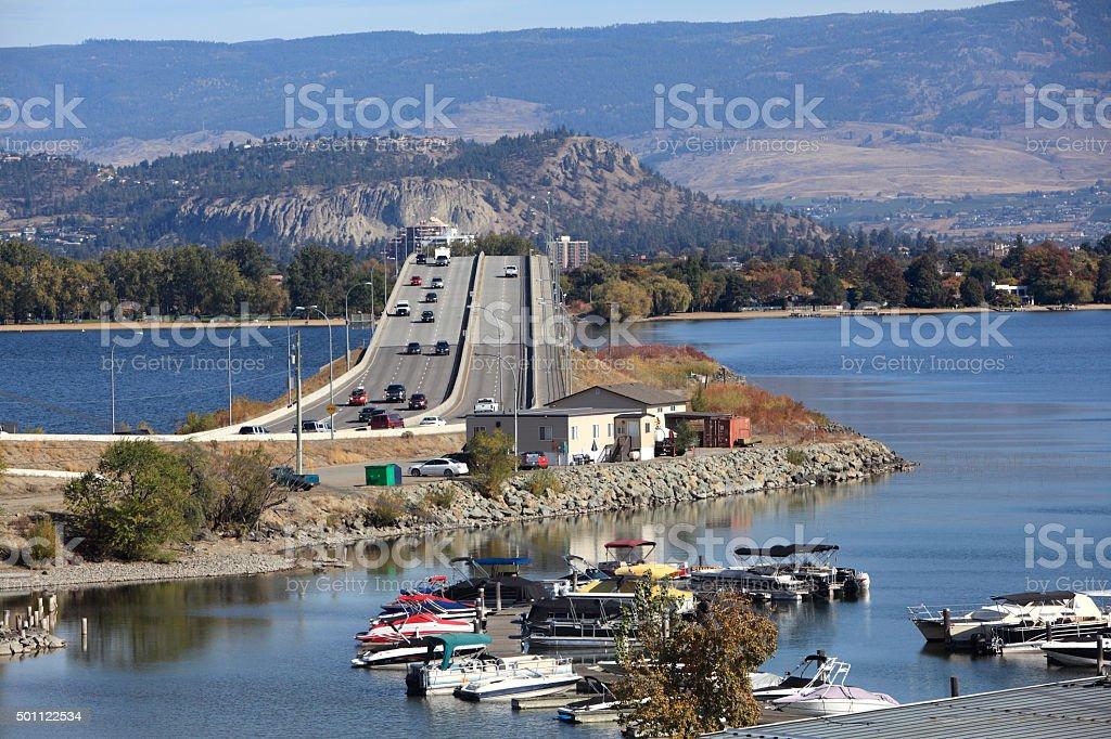 Cars And Bridge Over Lake Okanagan Kelowna stock photo