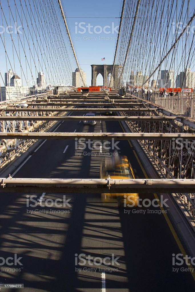 Cars and people on the Brooklyn Bridge royalty-free stock photo