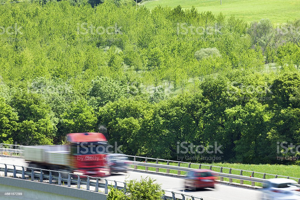 Cars and Truck Driving Fast on Country Road, Tuscany, Italy royalty-free stock photo