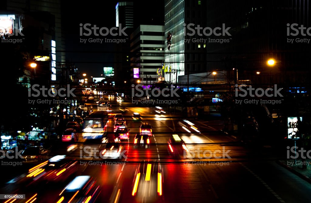 cars by night on a main road in Bangkok with lights on stock photo