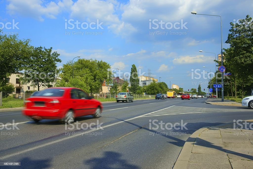 Cars coming to a junction with traffic lights, urban scene royalty-free stock photo