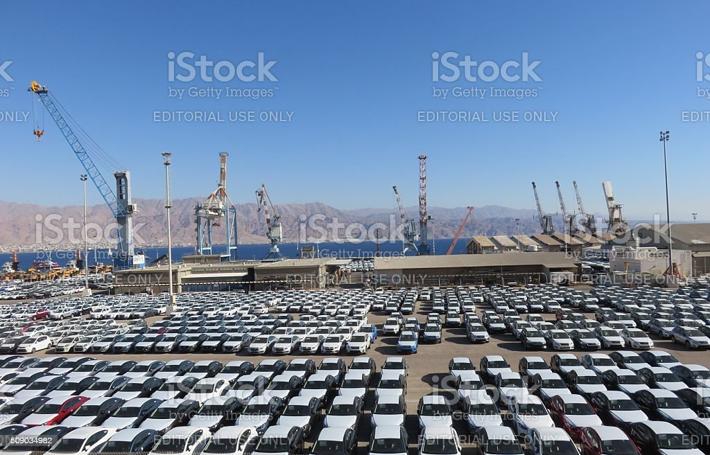 cars covered in protective white sheet stock photo