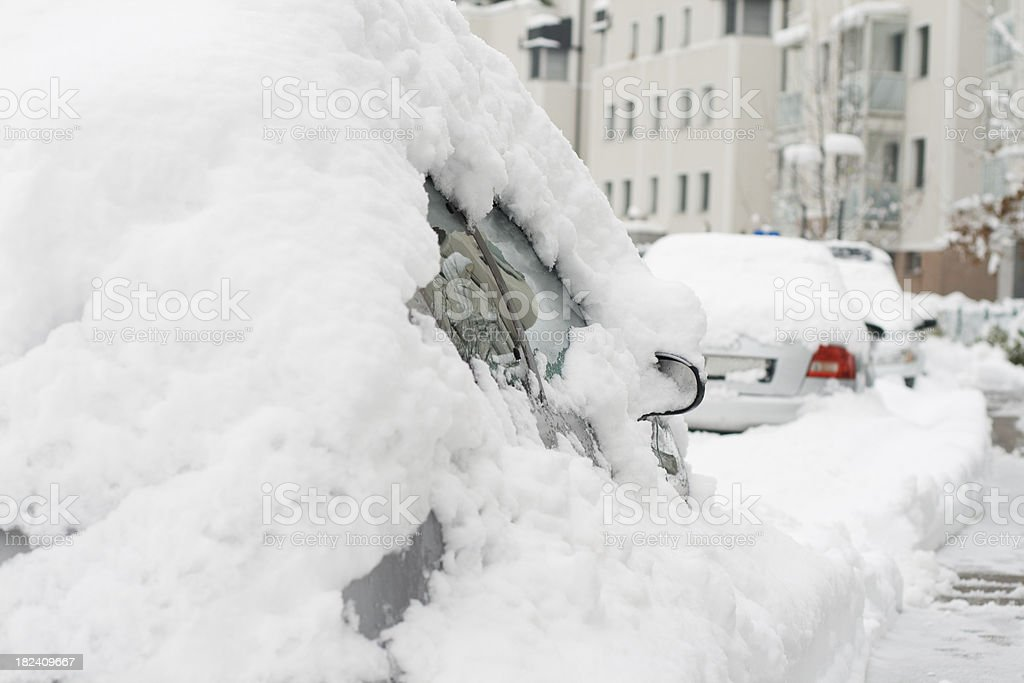 Cars covered with snow in city street royalty-free stock photo