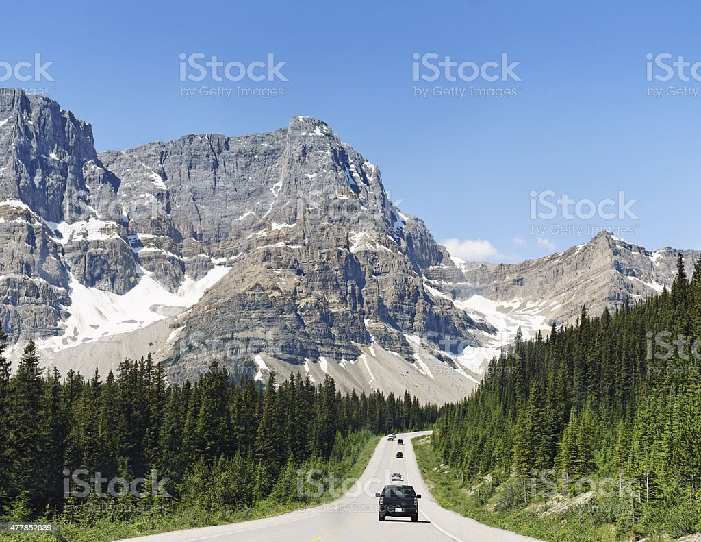 Cars driving along the Icefields Parkway in Canadian Rocky Mountains stock photo
