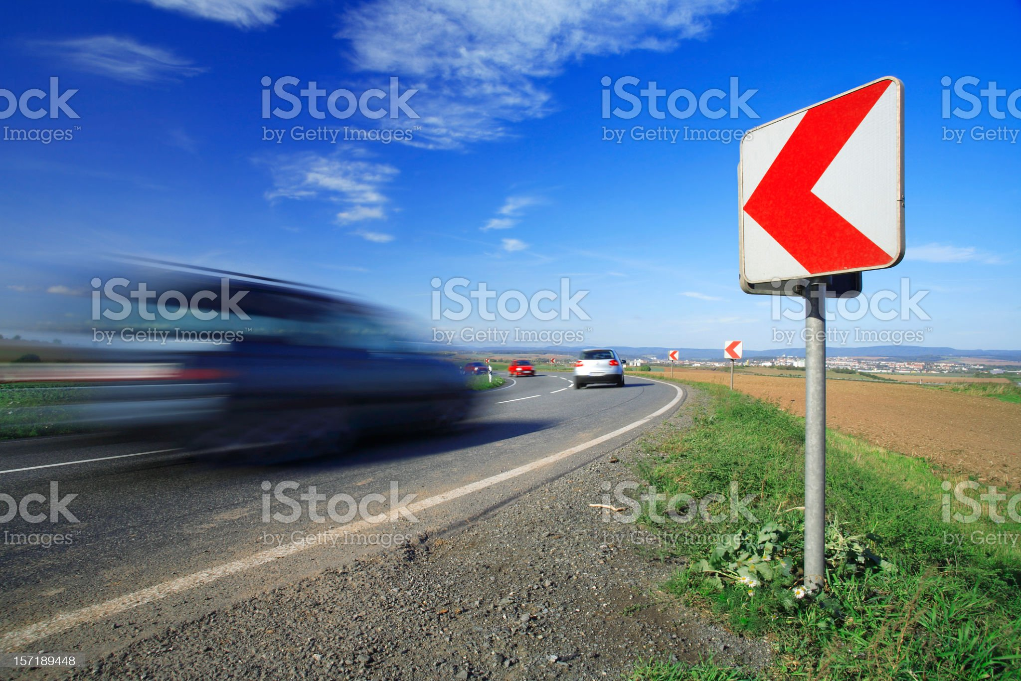 Cars Driving Down a Winding Road royalty-free stock photo