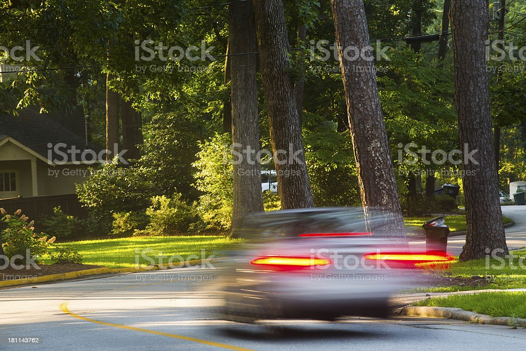 Cars driving down suburban streets royalty-free stock photo