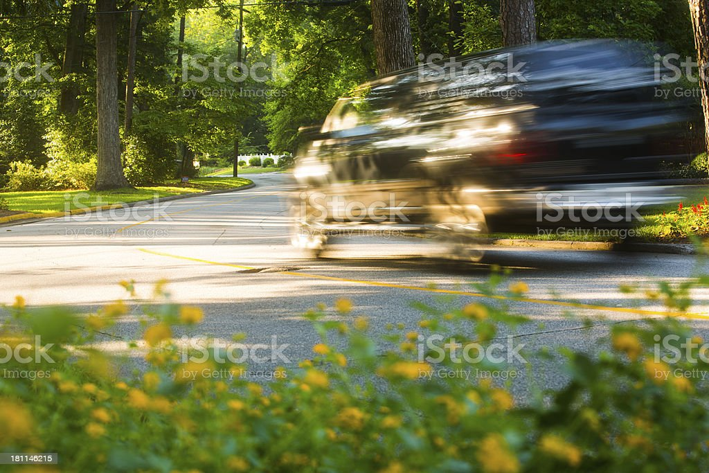 Cars driving down suburban streets royalty-free stock photo