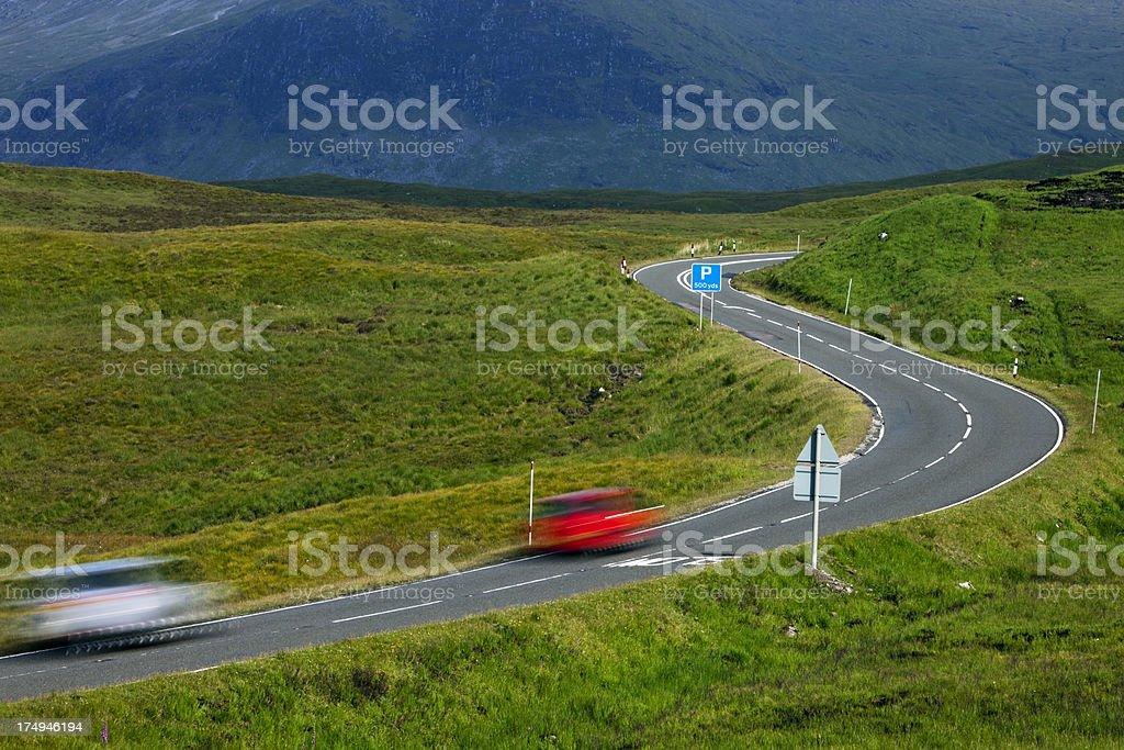 Cars Driving Down Winding Road, Glencoe, Scotland, UK royalty-free stock photo
